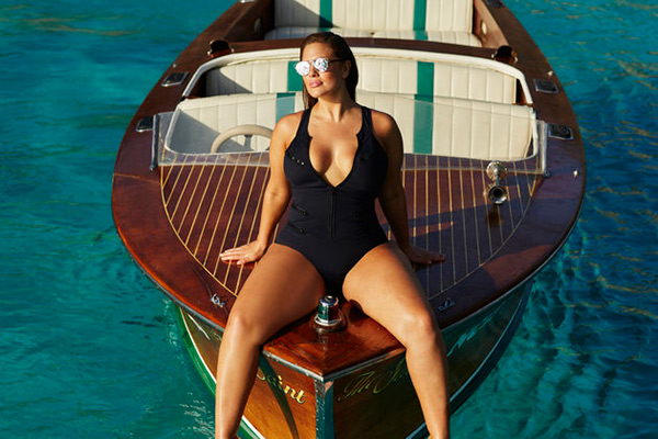 Ashley Graham posing on boat for Swimsuitsforall in her own collection