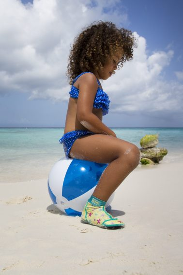 Girl playing with beach ball
