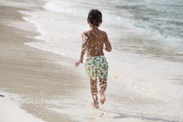 Boy running in new collection of Ramatuelle Beachwear