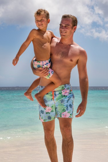 Father holding son for shoot in Curacao