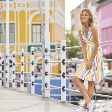 Model standing on the floating bridge in the colorful historical city center of Willemstad