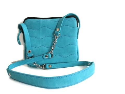 Pochette cuir bandoulière bleu turquoise