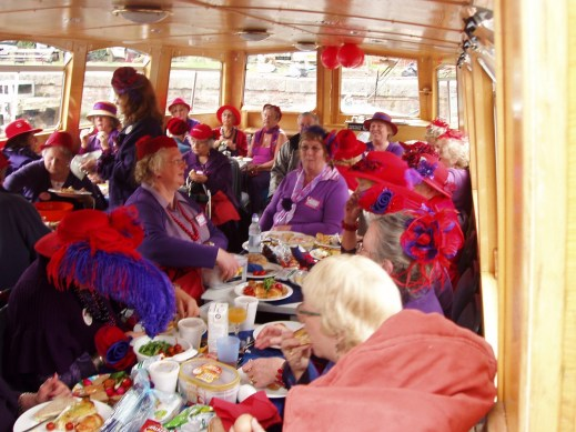 Ladies in red aboard canal boat Richmond