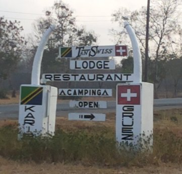 If you travel beyond the park, you'll see this Tan-Swiss Lodge Road Sign.