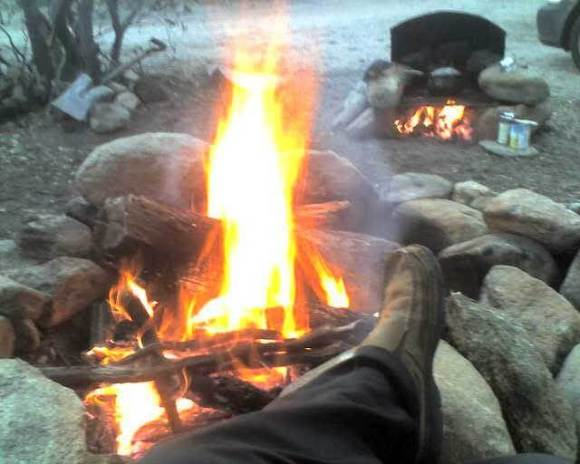 person relaxing at campfire, campfire oven