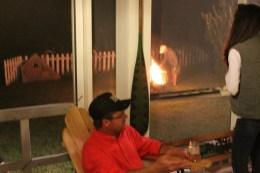 Pat lights a fire