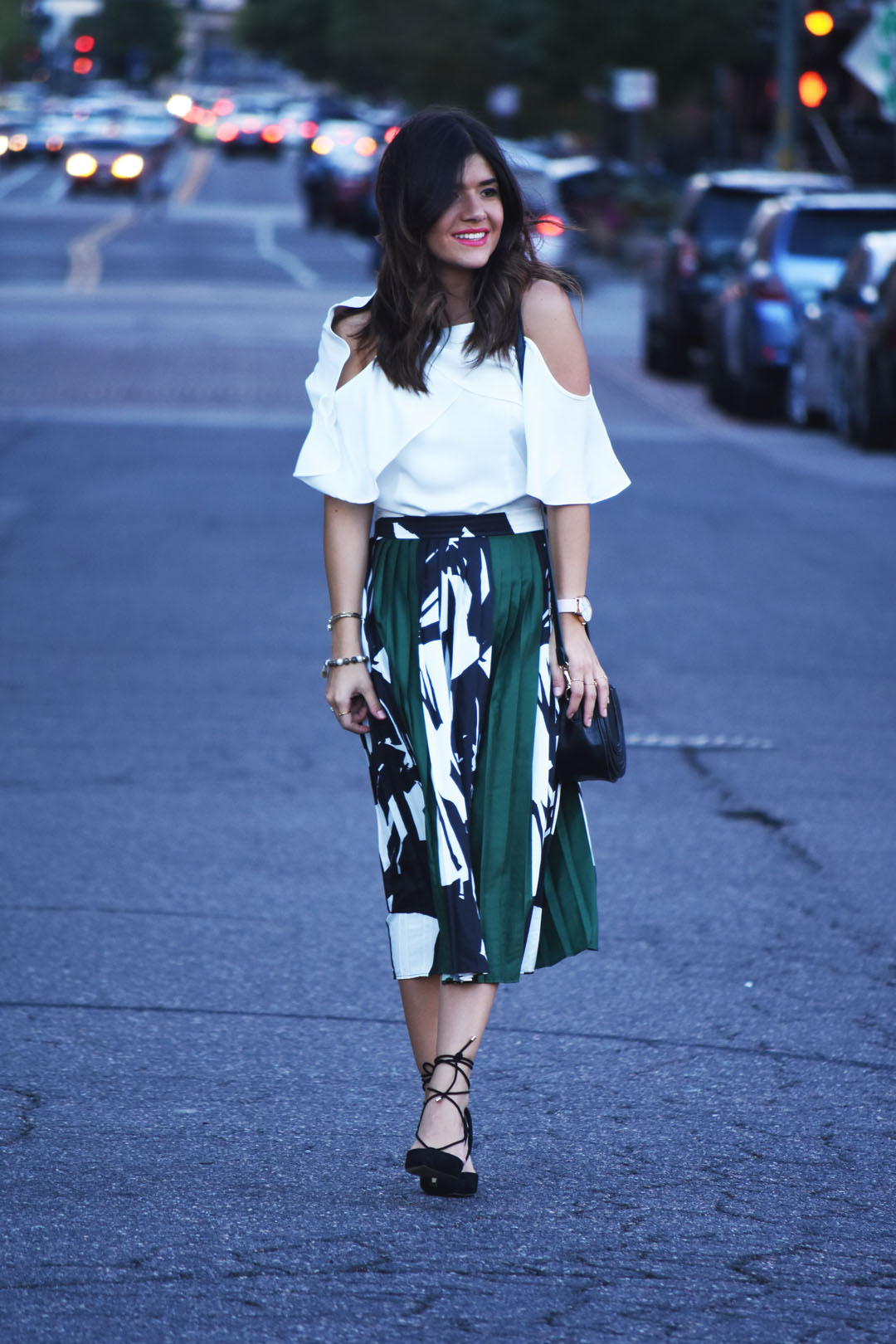 Carolina Hellal of Chic Talk wearing a Chicwish pleated skirt , cold shoulder top and Aldo pointy black pointy pumps