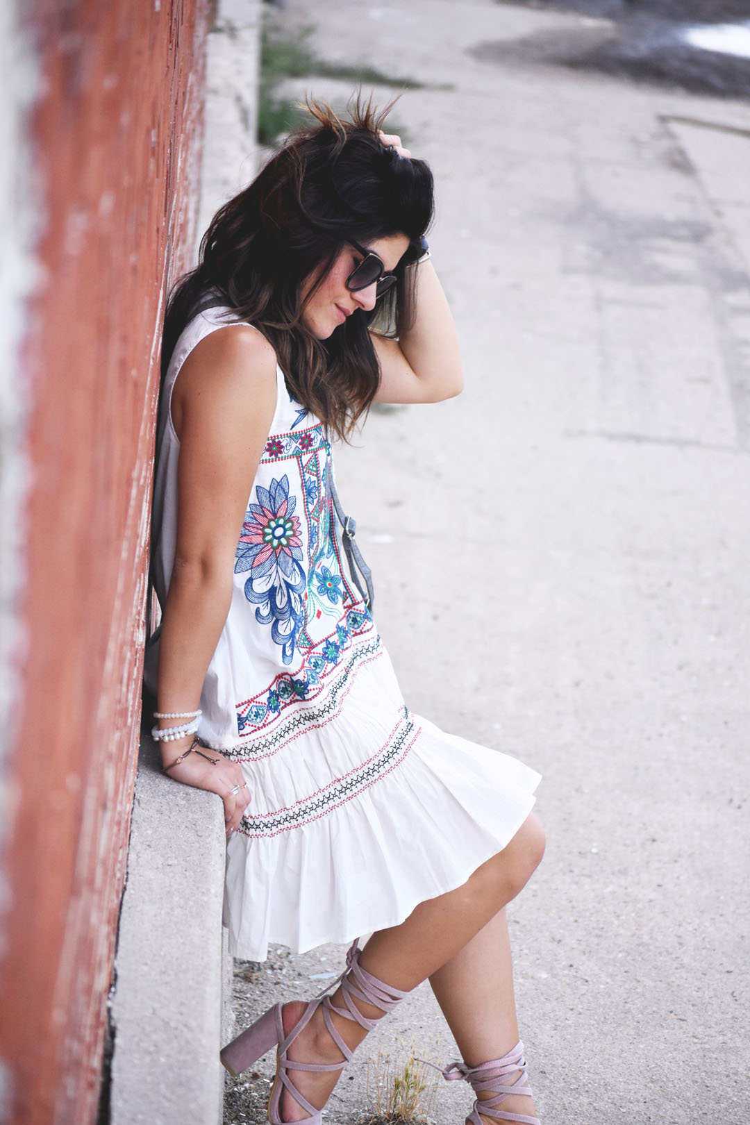 Carolina Hellal of the fashion blog Chic Talk wearing a Chicwish dress with floral embroidery and aztec details