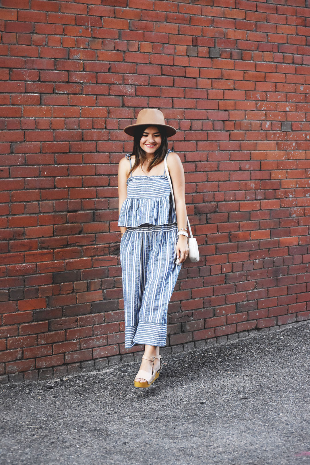 Carolina Hellal of Chic Talk wearing a summery look with a set of striped pants and top via Chicwish and Sam Edelman platforms.
