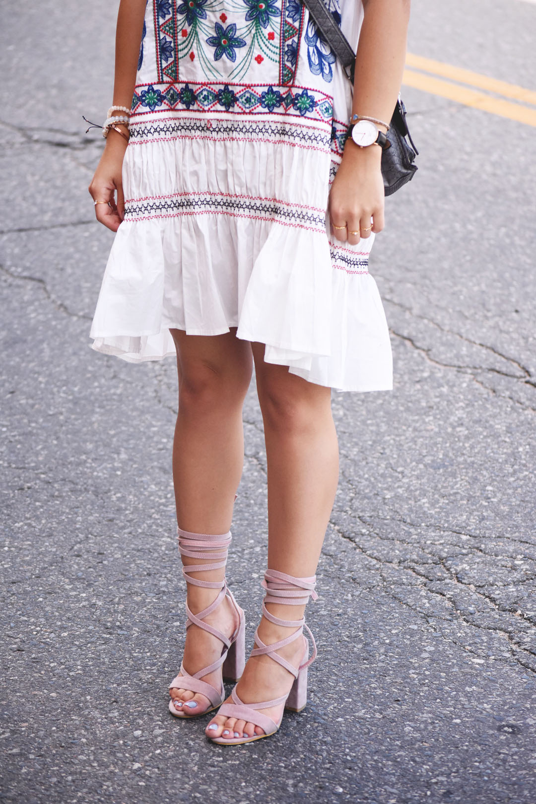 Chicwish white dress with floral and aztec embroidery, Daniel Wellington brown watch and Public Desire pink lace up sandals