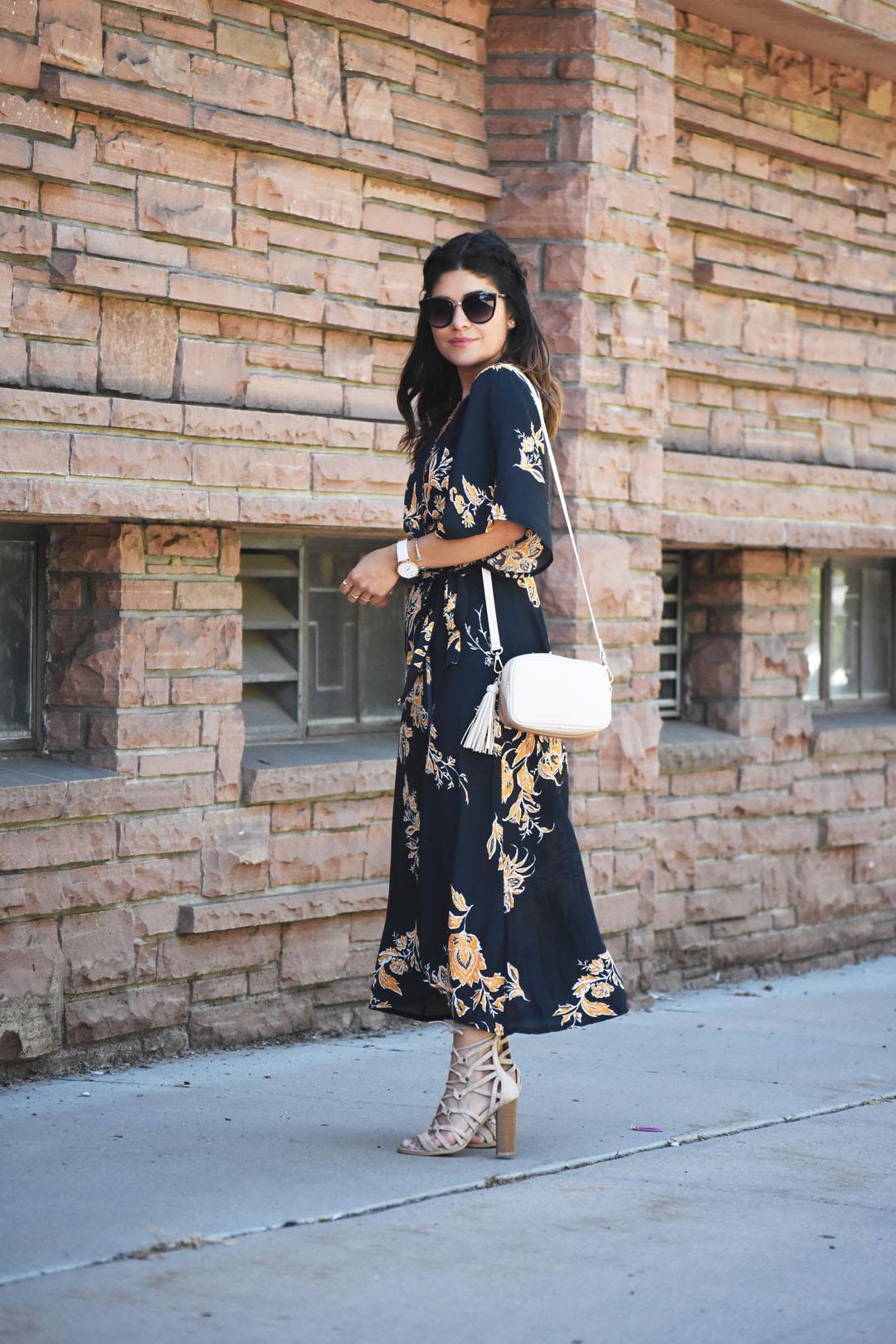 Carolina Hellal wearing a SheIn floral wrap maxi dress, Lasula Boutique lace up sandals, and H&M tassle bag.
