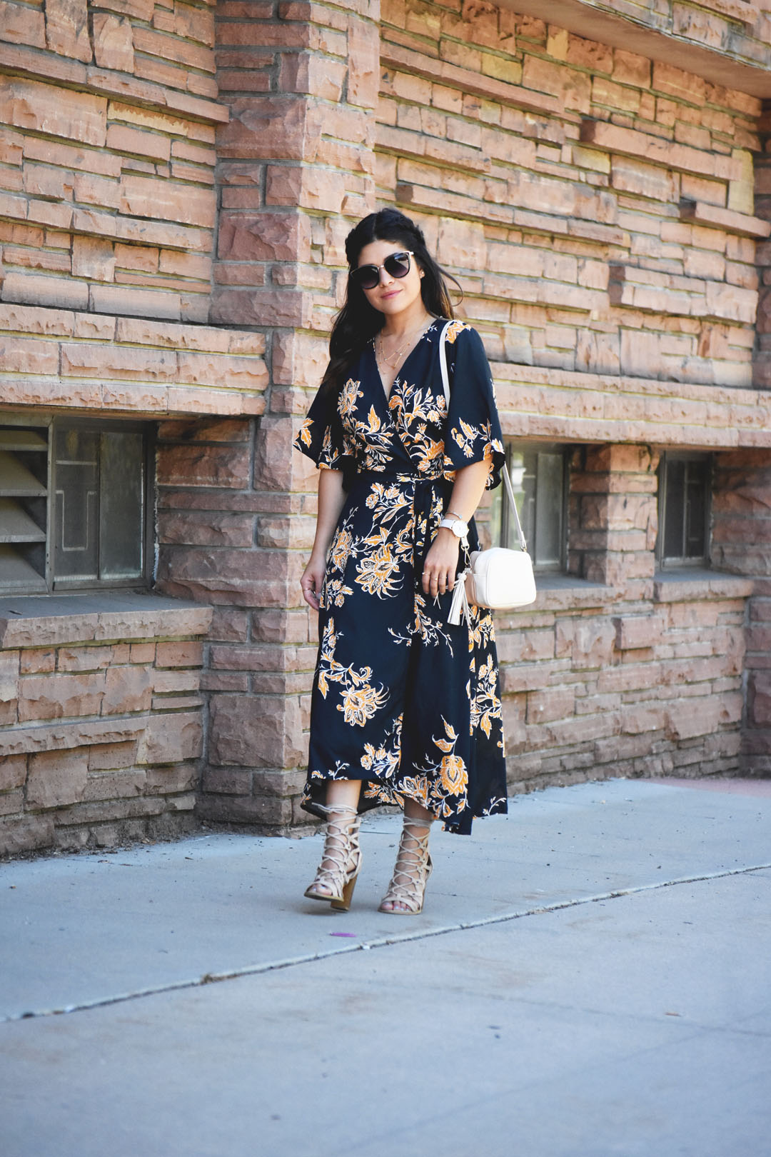 Carolina Hellal of Chic Talk wearing a floral maxi dress, Lasula lace up beige sandals, and an h&m beige crossbody bag.