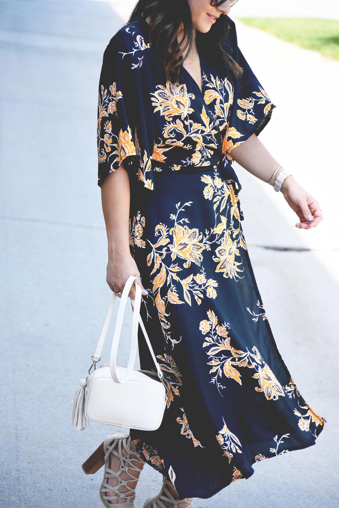 Carolina Hellal wearing a floral maxi dress and h&m beige crossbody bag.