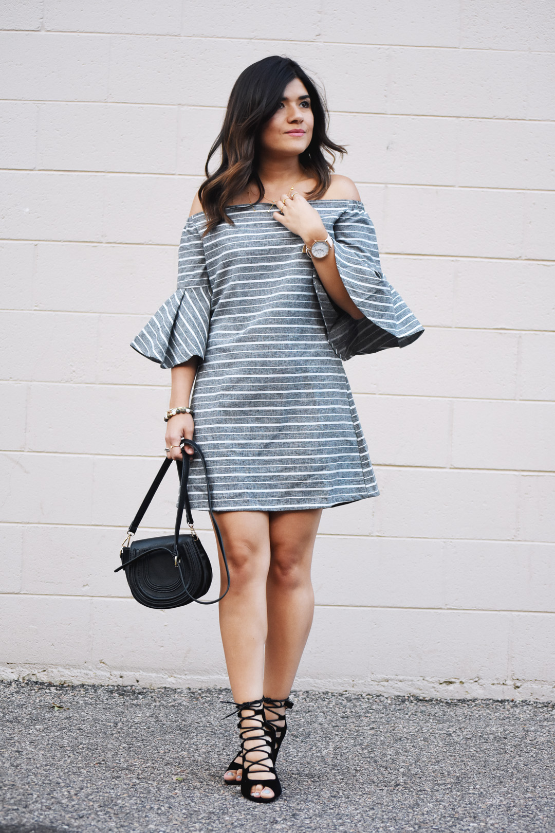 Carolina Hellal of Chic Talk wearing a Chicwish off the shoulder dress, Public desire black lace up sandals, and Mellow handbag world bag.