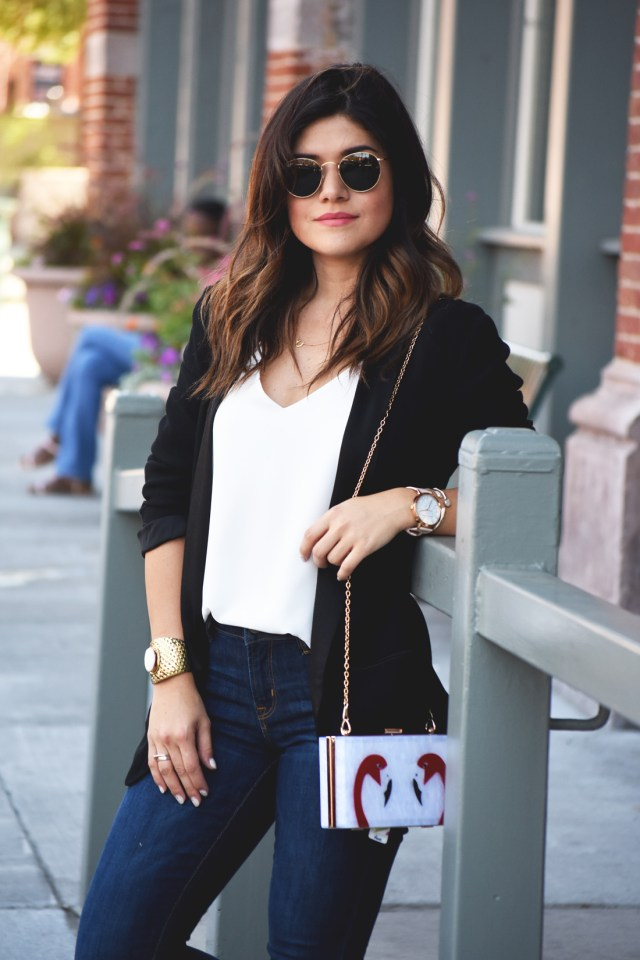 Carolina Hellal of Chic Talk wearing Rayban Rounded sunglasses, an H&M black blazer, a white Topshop top, and Old Navy jeans.
