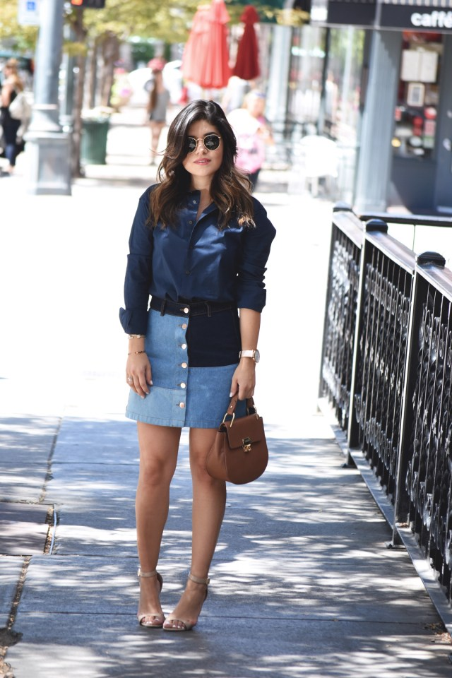 Carolina Hellal of Chic Talk wearing an H&M patch denim skirt, Steve Madden strap sandals, BIS Jeans button down shirt, and Rayban rounded sunglasses.