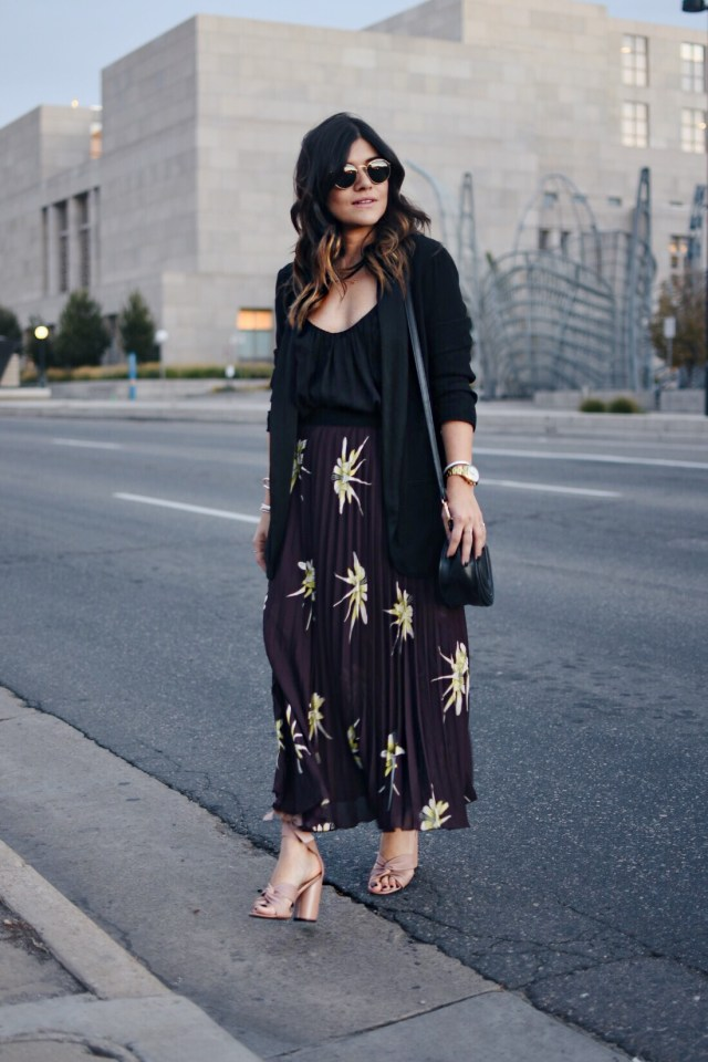 Carolina Hellal of Chic Talk wearing an H&M pleated burgundy skirt, Black blazer , Rayban rounded sunglasses and Topshop blush sandals