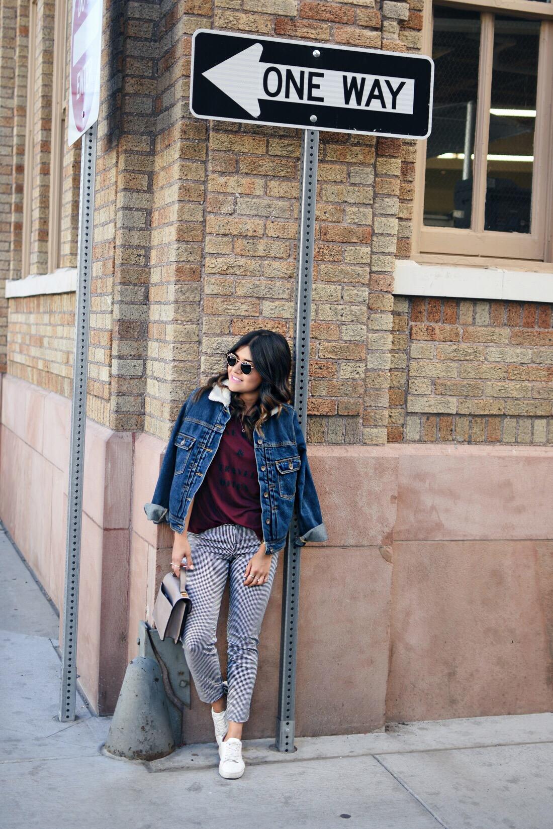 Carolina Hellal of Chic Talk wearing an Old navy burgundy T, denim jacket, printed pinxie pants, and Rayban rounded sunglasses