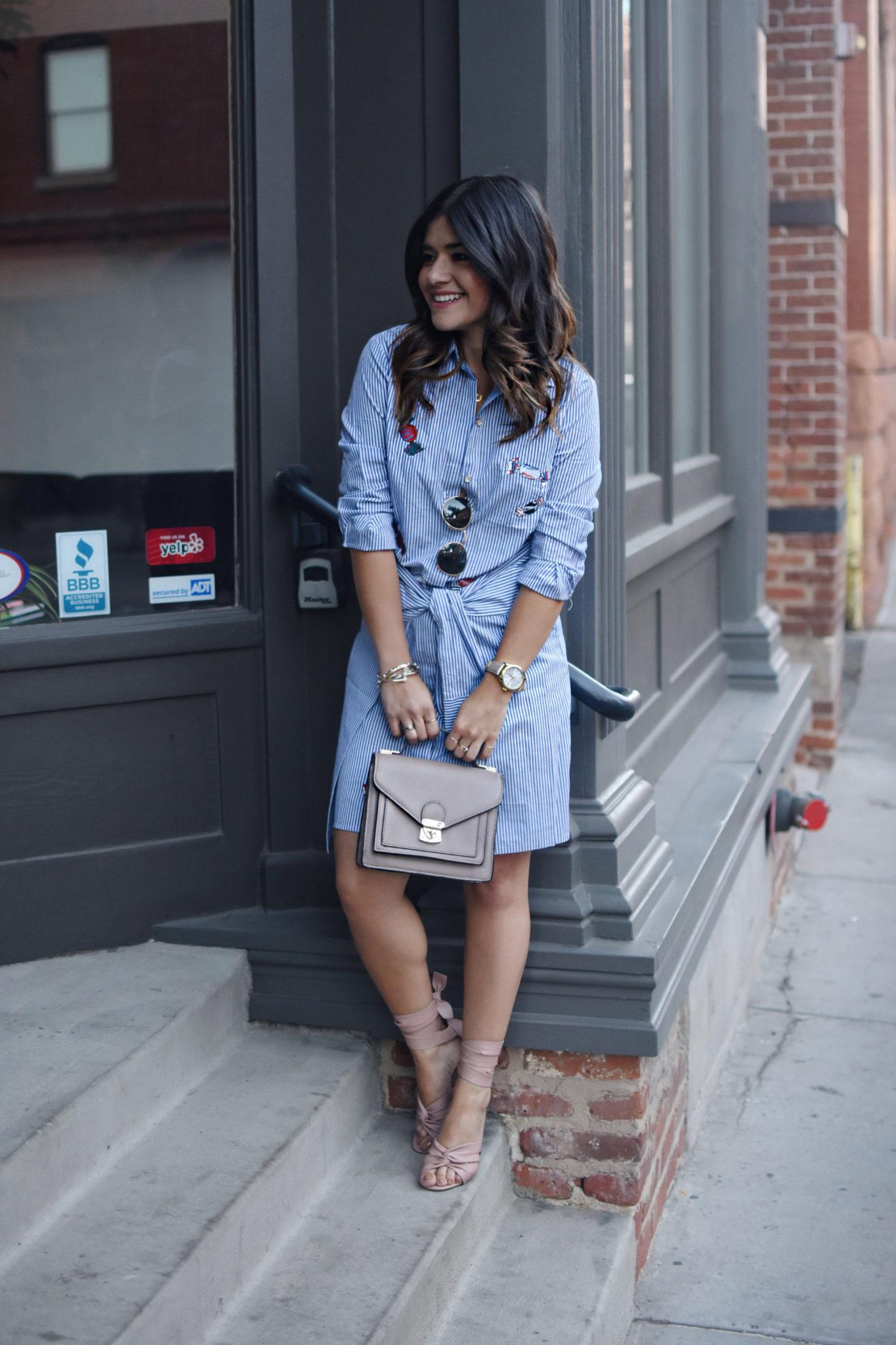 Carolina Hellal of Chic Talk wearing a VIPme stripped dress, Rayban 50mm rounded sunglasses, Timex gold watch.