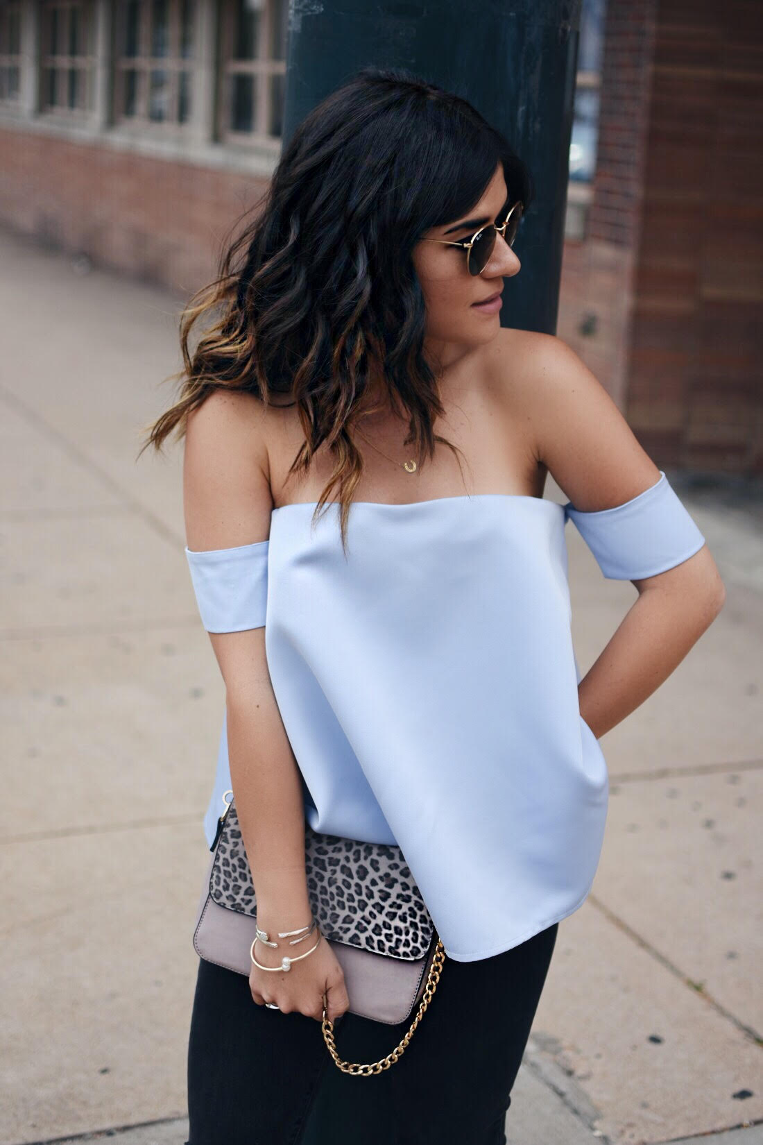 Carolina Hellal of Chic Talk wearing a chicwish top, and Rayban rounded sunglasses
