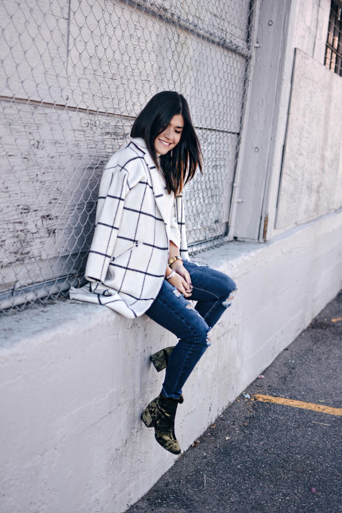 Carolina Hellal of Chic Talk wearing a Chicwish plaid coat, american eagle jeans, EGO green velvet booties, and forever21 beige sweater