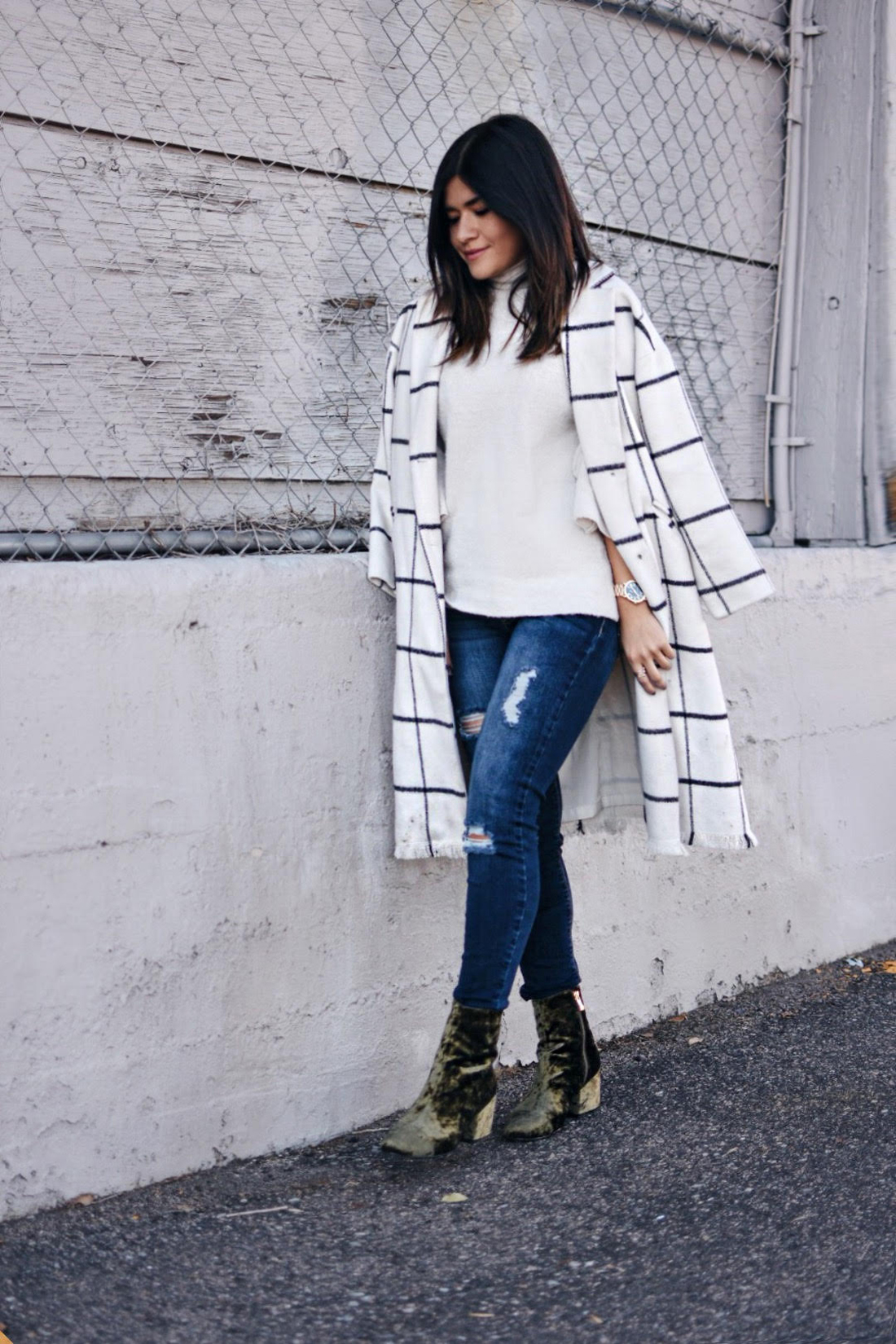 Carolina Hellal of Chic Talk wearing a Chicwish plaid coat, American Eagle jeans and EGO green velvet booties