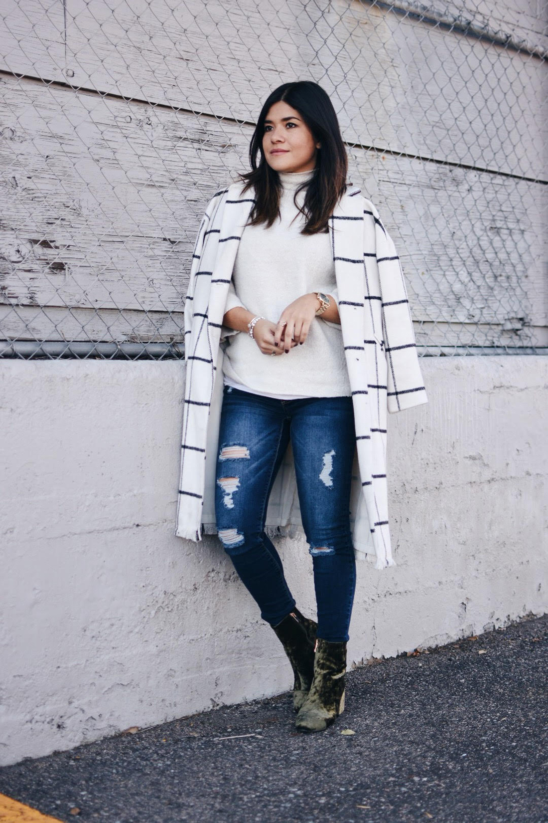 Carolina Hellal of Chic Talk wearing a Chicwish plaid coat, American Eagle jeans, EGO green velvet booties and a Forever21 beige sweater