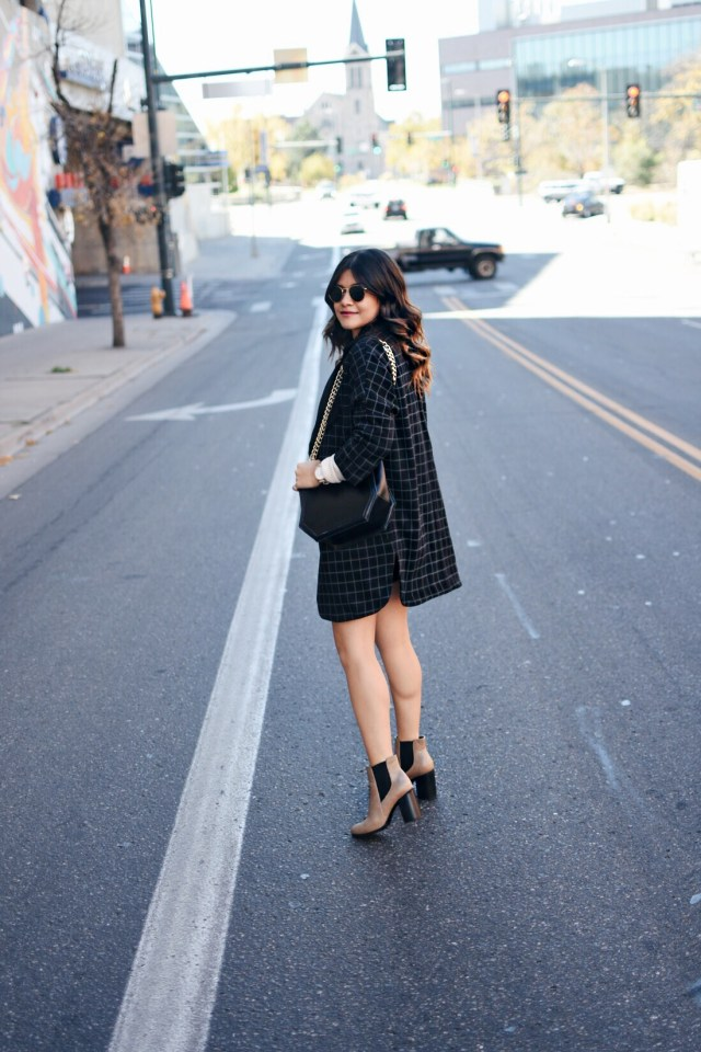 Carolina Hellal of Chic Talk wearing a VIPme plaid coat, Forever21 faux leather skirt, Stage beige sweater and Forever21 nude booties