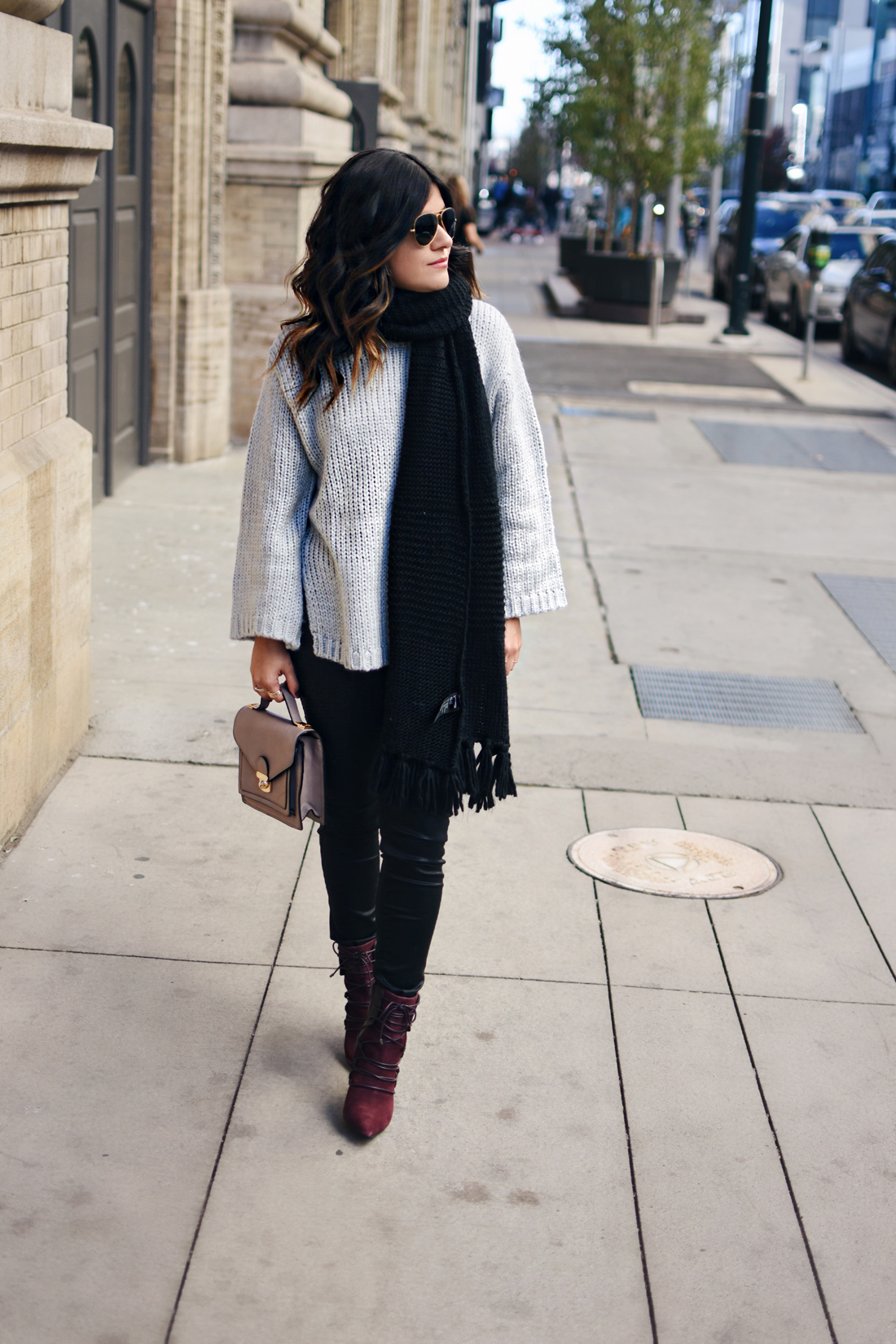 Carolina Hellal of Chic Talk wearing a Chicwish  knit sweater, Madewell coated jeans, Nine West lace up booties and Rayban aviator sunglasses