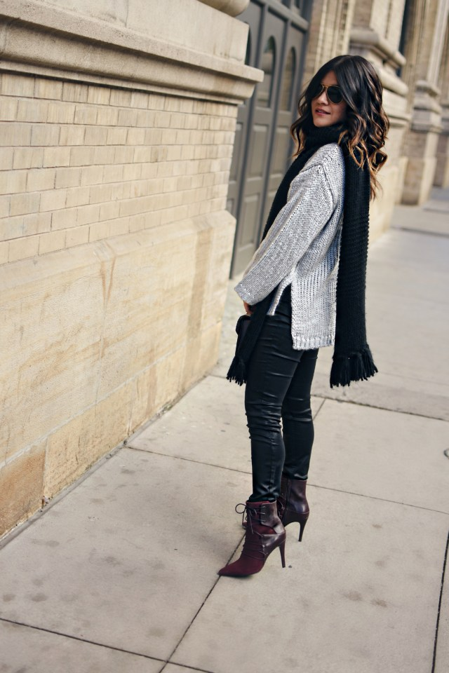 Carolina Hellal of Chic Talk wearing a Chicwish grey knit sweater, Rayban aviator sunglasses, Madewell coated skinny jeans and Nine West burgundy booties