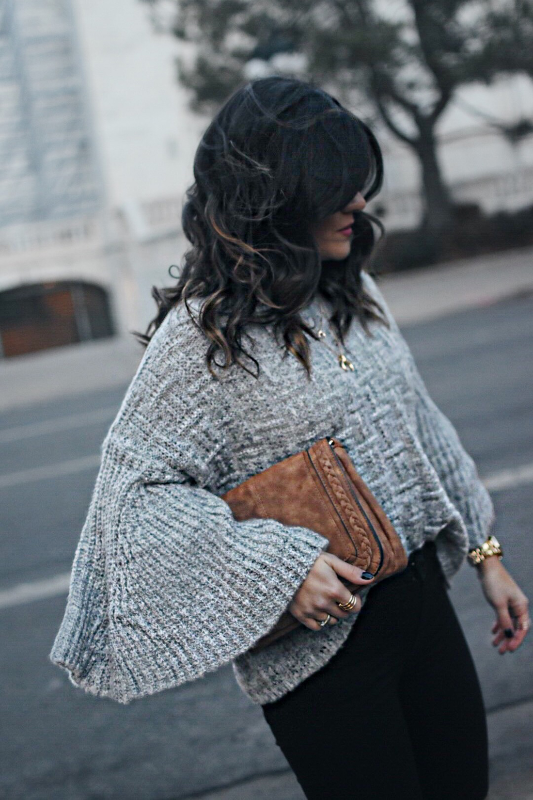Carolina Hellal of Chic Talk wearing a Shein sweater and Violet Ray bag