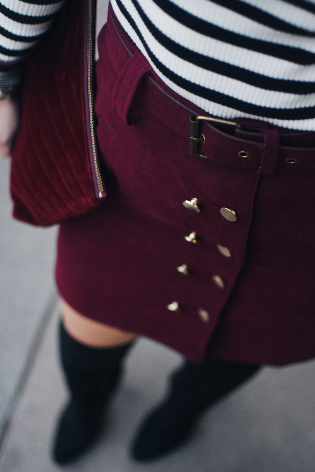 Carolina Hellal of Chic Talk wearing a SheIn burgundy mini skirt, Gap ribbed turtleneck sweater and black boots