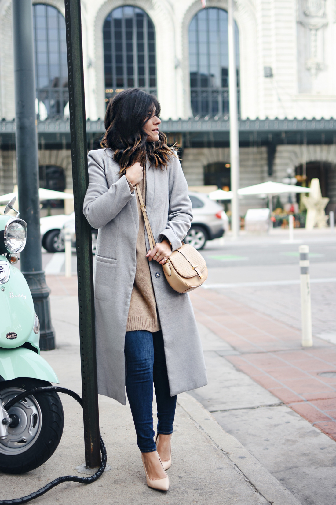 Carolina Hellal of Chic Talk wearing a Shein gray long coat, Paige skinny jeans, Calvin Klein bag, NA-KD sweater, and Sam Edelman Shoes.