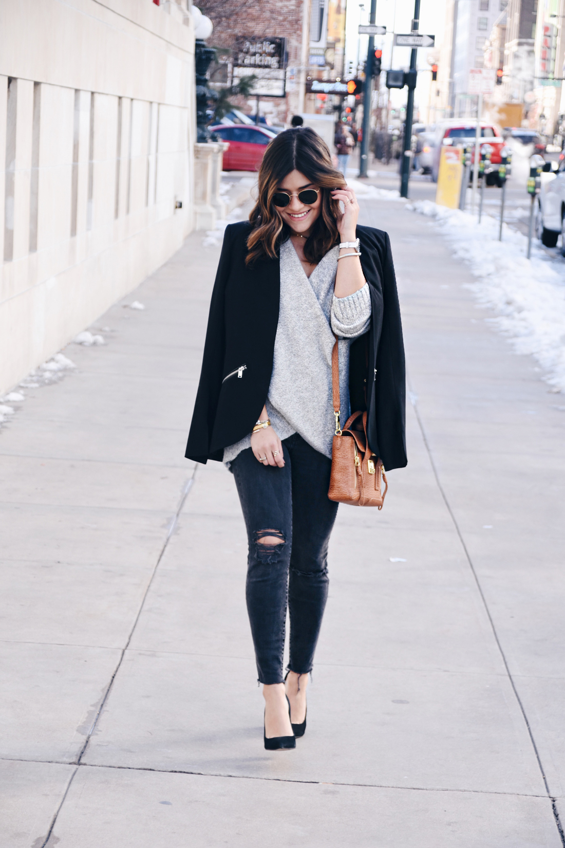 Carolina Hellal of Chic Talk wearing Madewell jeans, Rayban Sunglasses, 3.1 Phillip Lim bag, Steve Madden pumps, and Chicwish cross front sweater