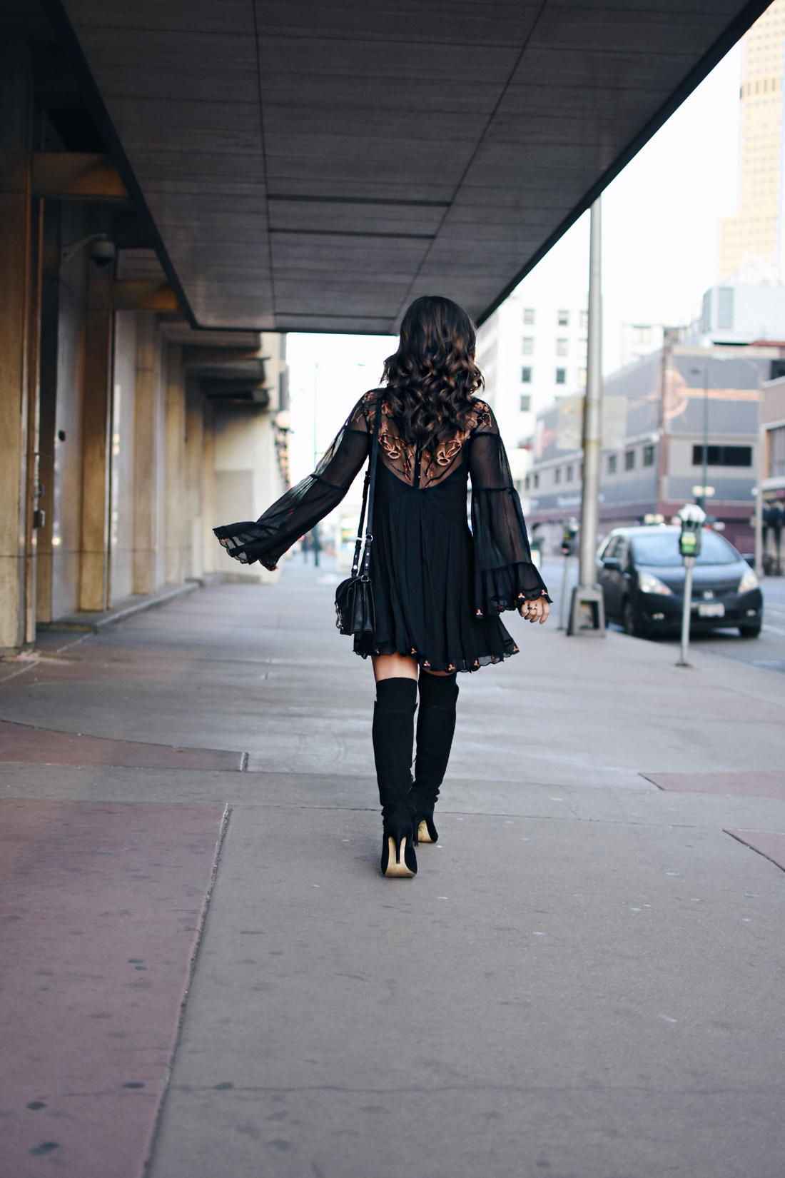 Carolina Hellal of Chic Talk wearing a Free People dress, Rebecca Minkoff crossbody bag and Vince Camuto over the knee black boots