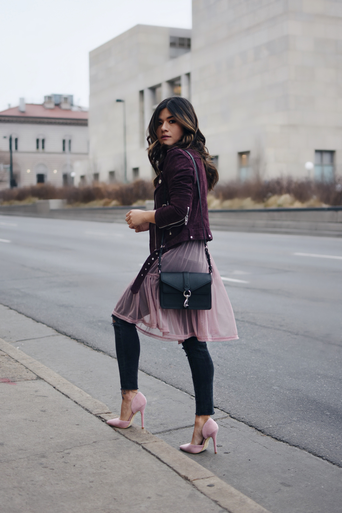 Carolina Hellal of Chic Talk wearing a Nordtrom suede burgundy jacket, madewell jeans, River Island tulle top in lilac, Rebecca Minkoff bag, and public Desire shoes