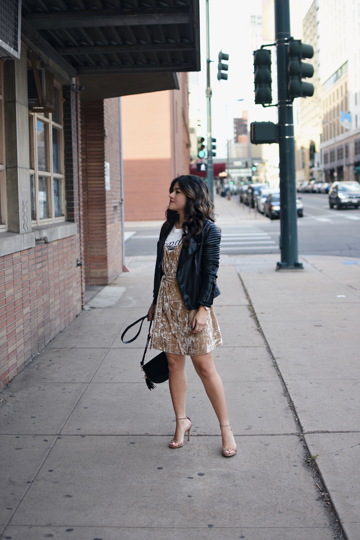 Carolina Hellal of Chic Talk wearing a crushed velvet dress via Shein, Topshop fauc leather jacket, Blondie t-shirt, Steve Madden sandals, and Rebecca Minkoff crossbody bag