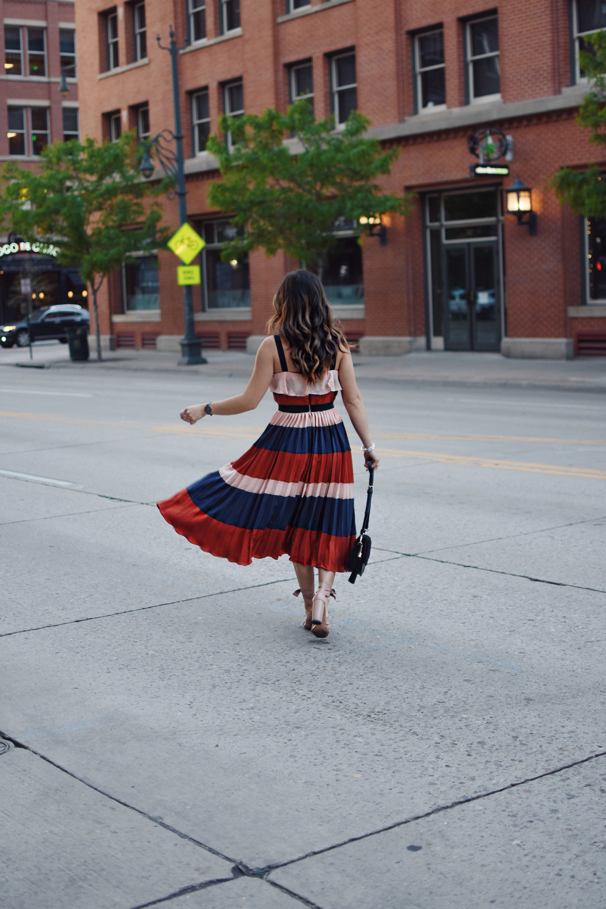 Carolina Hellal of Chic Talk wearing an Endless Rose striped midi dress via shopbop