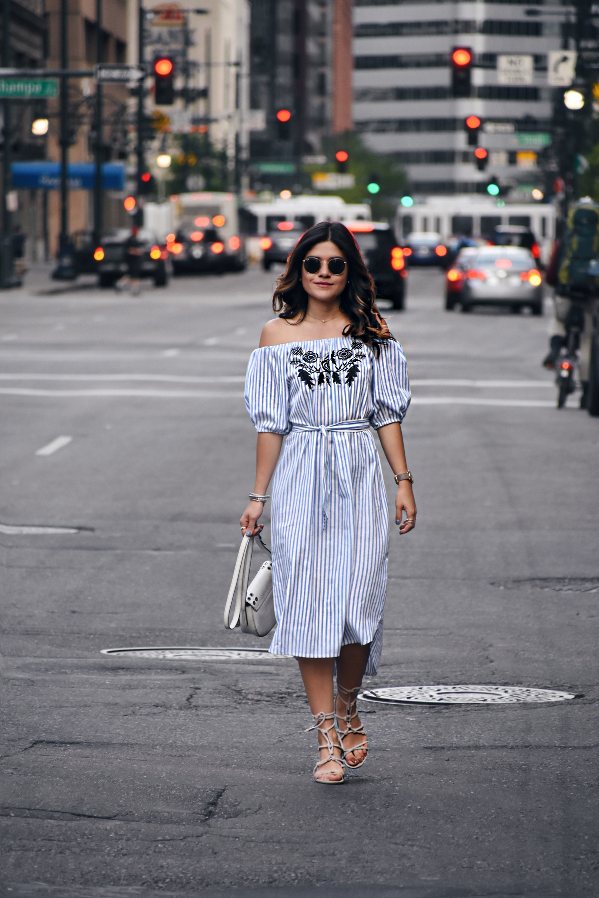Carolina Hellal in downtown Denver wearing an off the shoulder shein dress, rayban sunglasses, marc jacobs watch and rebrecca minkoff shoes