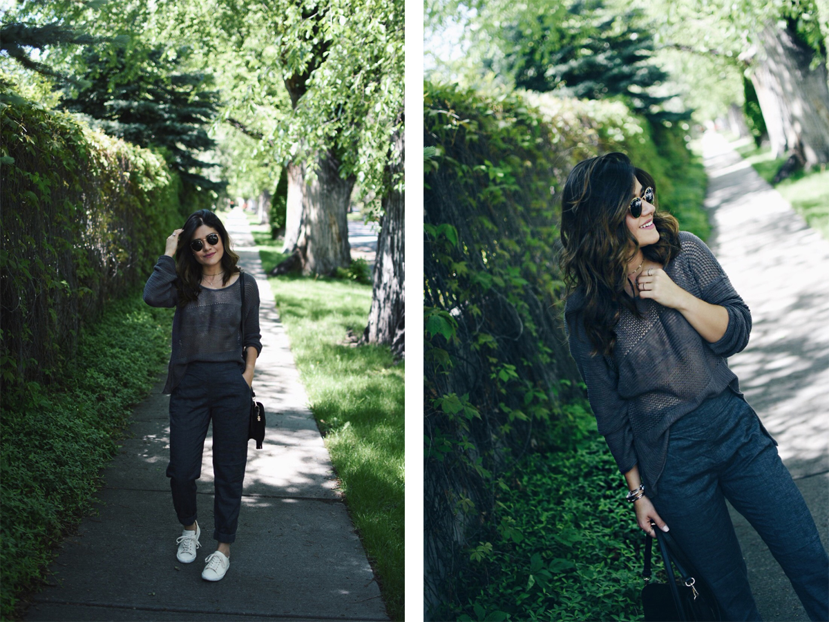 Carolina Hellal wearing PrAna pants and sweater, Sezane tennis shoes and Rayban rounded sunglasses.
