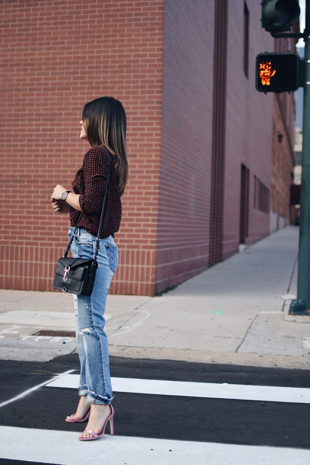 Carolina Hellal of Chic Talk wearing a DVF cross front top, Free People jeans, Rebecca Minkoff bag and Public Desire sandals.