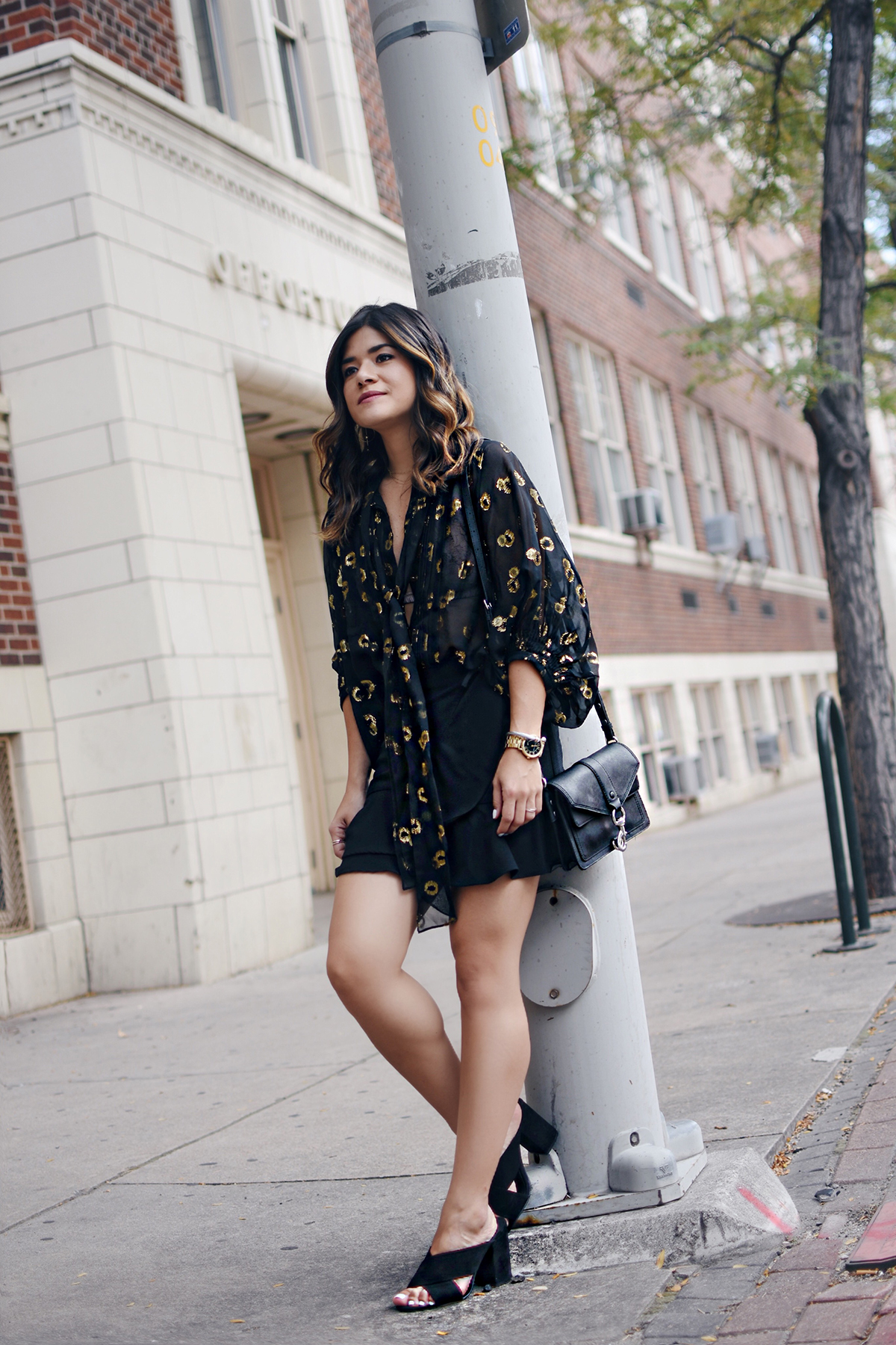 Carolina Hellal for Chic Talk wearing a DVF black top via Current Boutique, an online vintage and second hand-store.