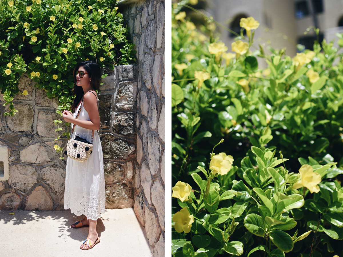 Carolina Hellal of Chic Talk wearing a J.O.A white summer dress, Rebecca Minkoff straw pom pom bag and Forever21 tassel sandals