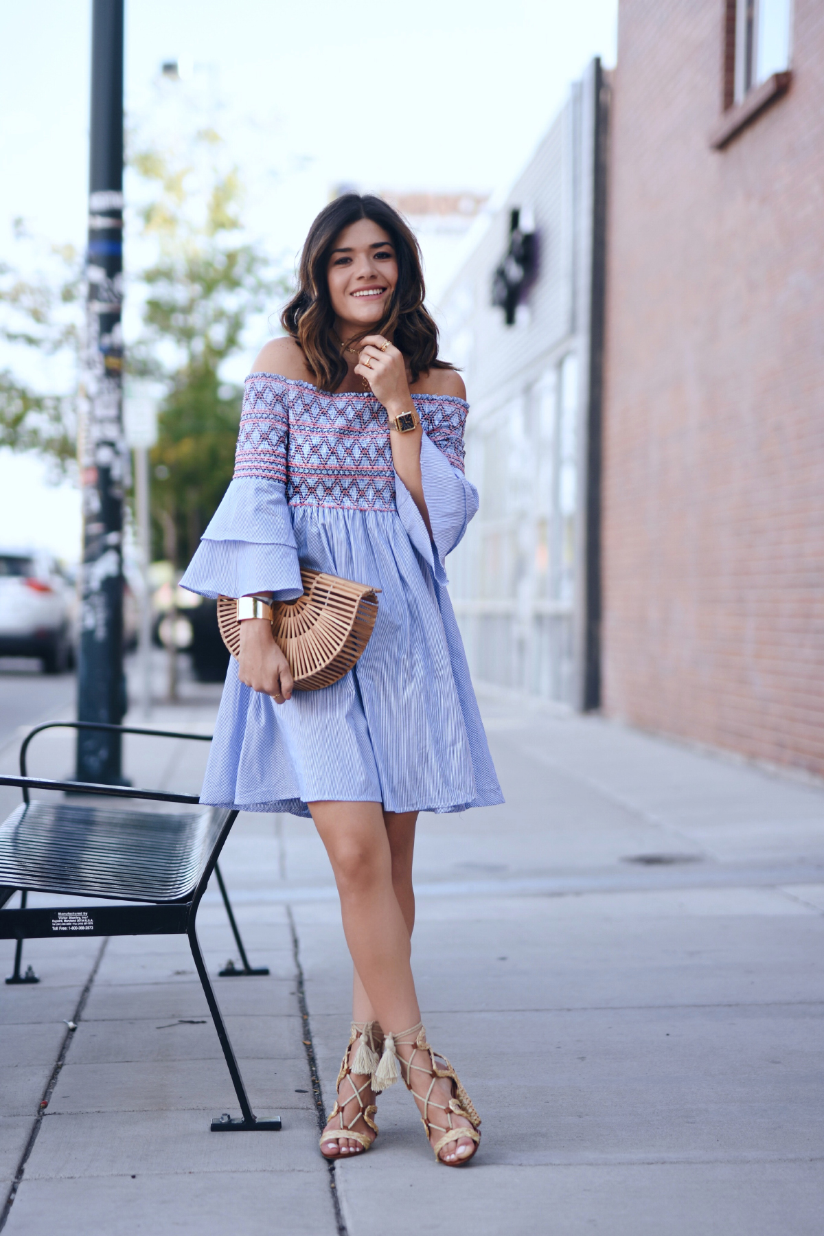 Carolina Hellal of Chic Talk wearing a Chicwish off the shoulder dress, wick lace up sandals and Cult Gaia ark bag