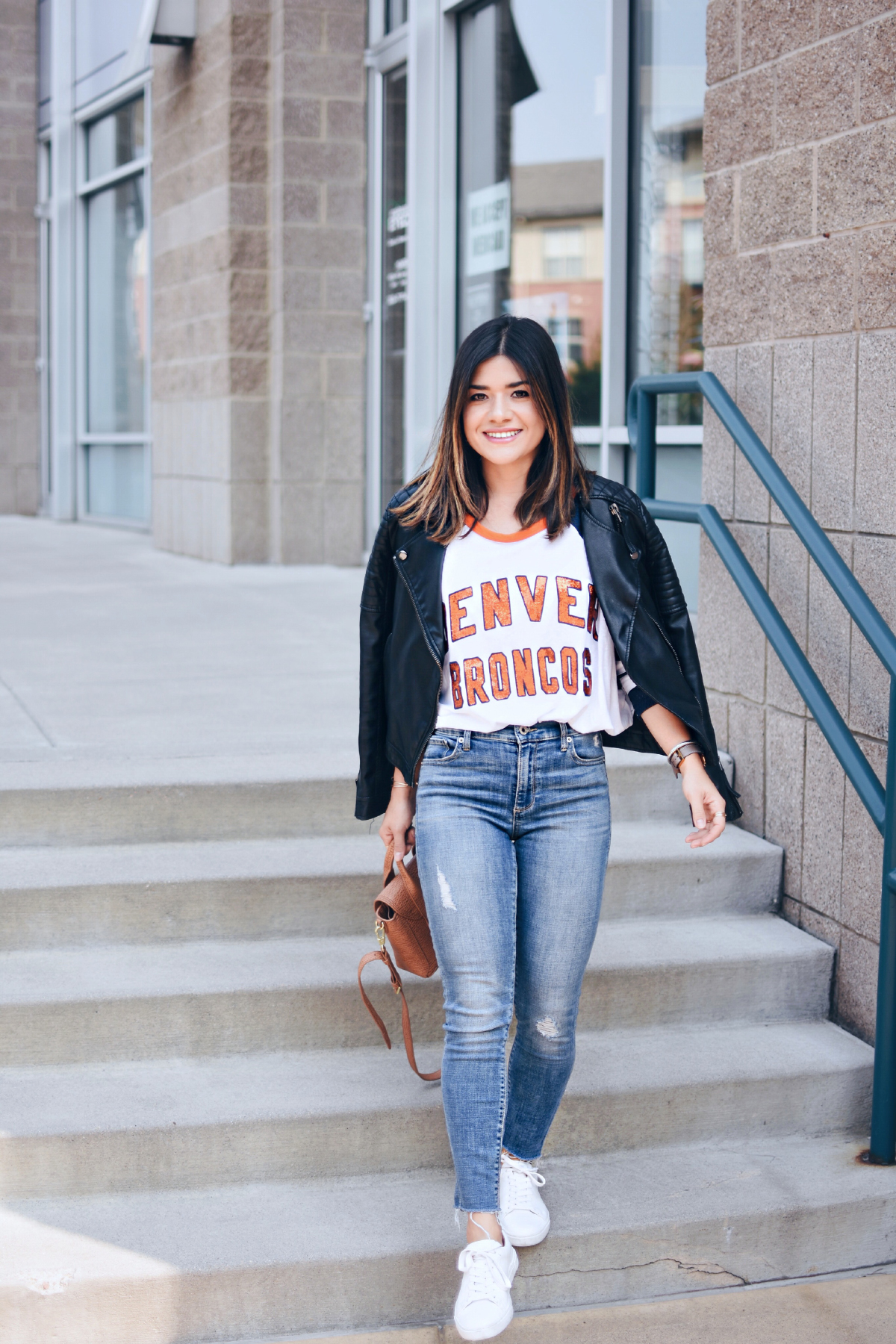 Carolina Hellal of Chic Talk wearing a Broncos Denver top, Topshop black faux leather jacket and Lucky brand jeans