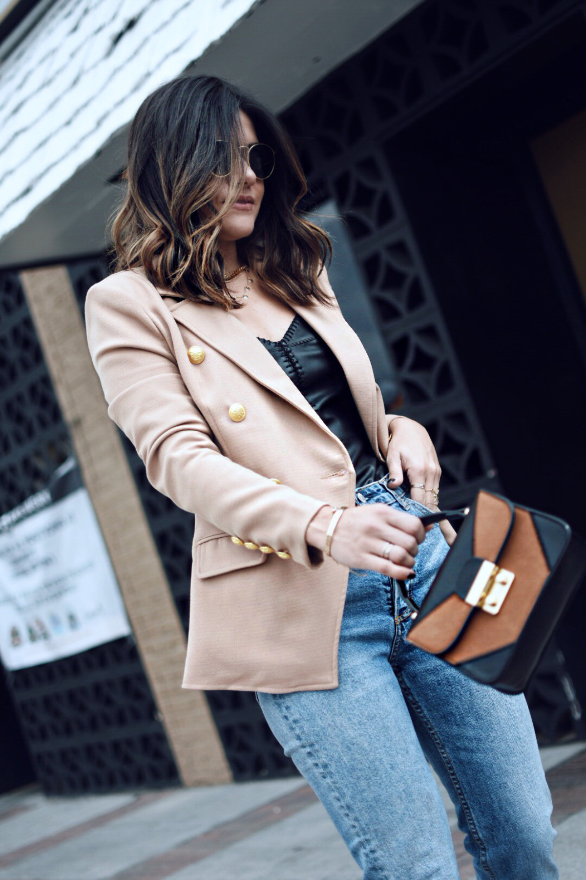 Carolina Hellal of Chic Talk wearing a Missguided blazer, Rag and bone jeans, Charming Charlie bag, Rayban sunglasses, and Sam Edelman nude pumps.