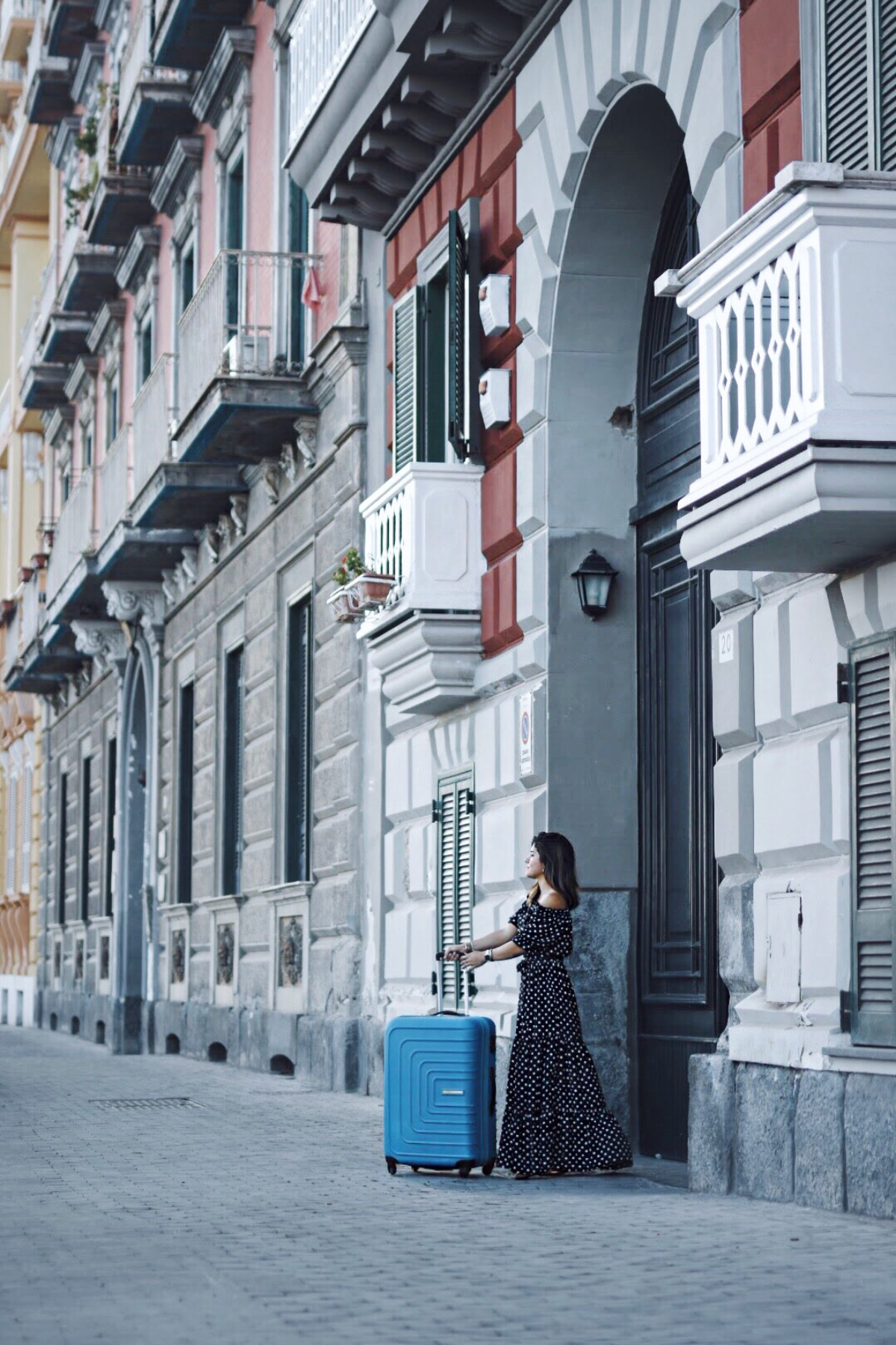 Carolina Hellal in Naples, Italy with an American Tourister bag