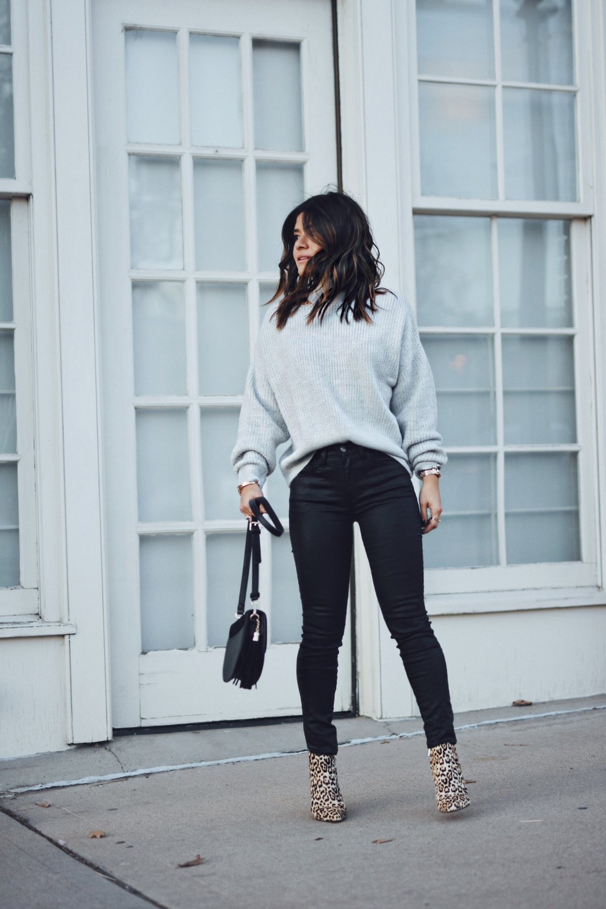 Carolina Hellal of Chic Talk wearing a Nordstrom sweater, Current Elliot jeans, Sam Edelman boots and Rebecca Minkoff bag