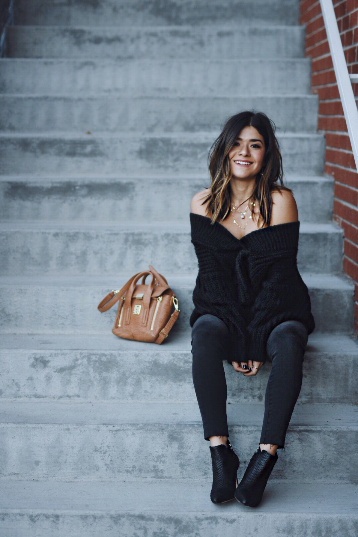 Carolina Hellal of Chic Talk wearing an off the shoulder dress, gray madewell jeans and 3.1 Phillip Lim bag