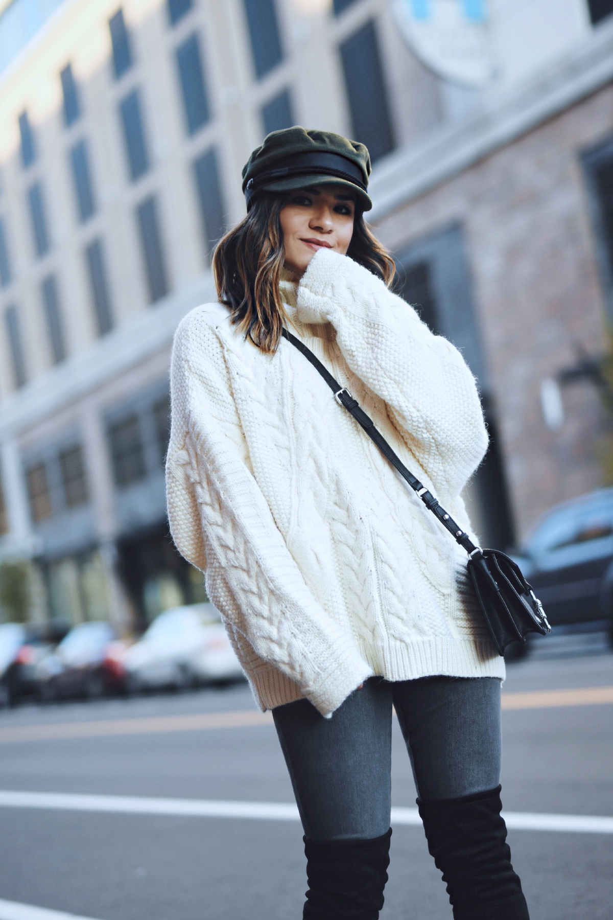 Carolina Hellal of Chic Talk wearing a knit sweater, AG Jeans, public desire boots and asos hat